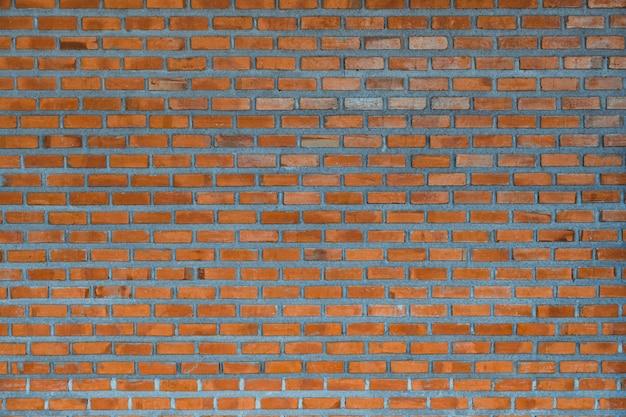 Красная предпосылка части кирпичной стены или текстура здания слоя кирпича. Premium Фотографии