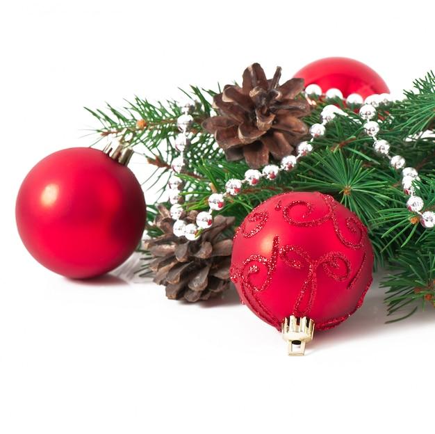 赤いベルとモミの枝付きのクリスマスカード 無料写真