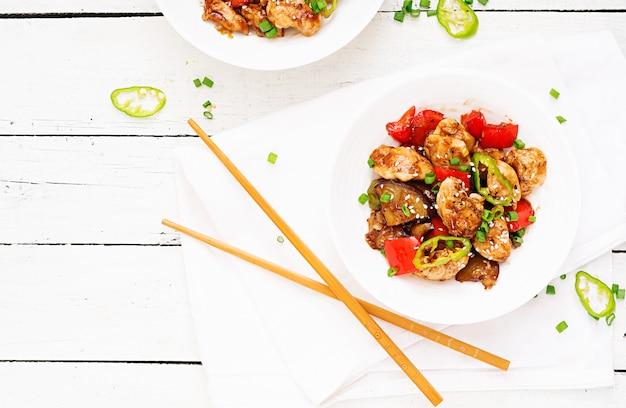 ピーマンと野菜の自家製クンパオチキン Premium写真