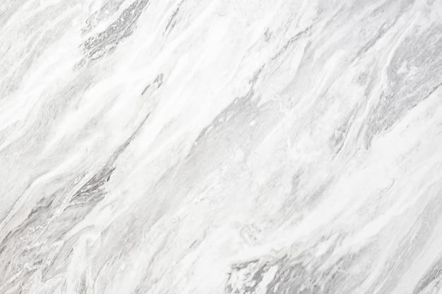 白い大理石のテクスチャ壁からの抽象的な背景。豪華な背景。 Premium写真