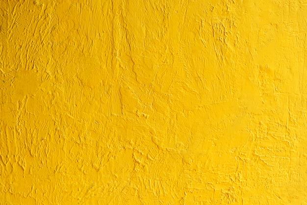 Абстрактная предпосылка от золотой текстуры стены с солнечным светом. роскошные и элегантные обои. Premium Фотографии