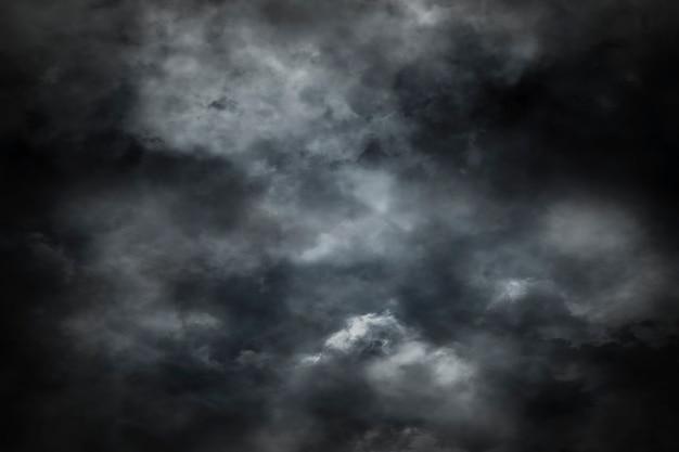 暗い背景に煙からの抽象的な背景 Premium写真