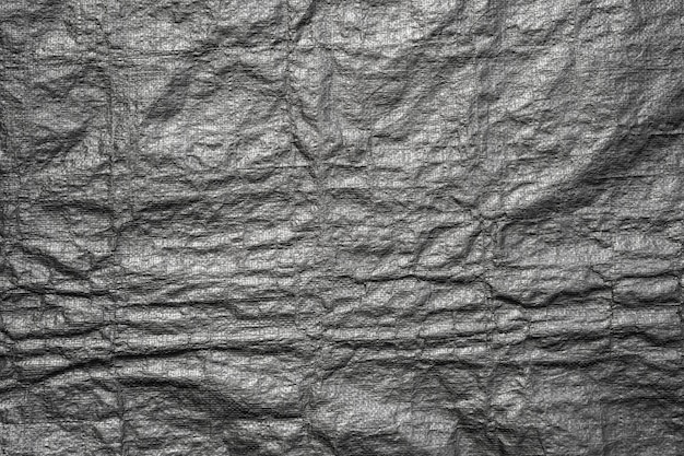 グランジと黒いビニール袋のテクスチャから抽象的な背景 Premium写真