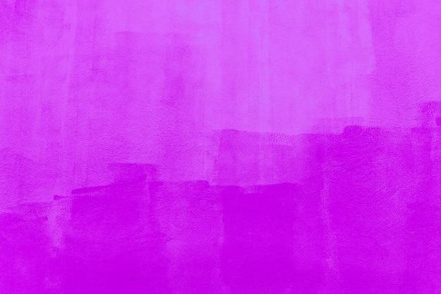 コンクリートの壁に描かれたピンク色からの抽象的な背景 Premium写真