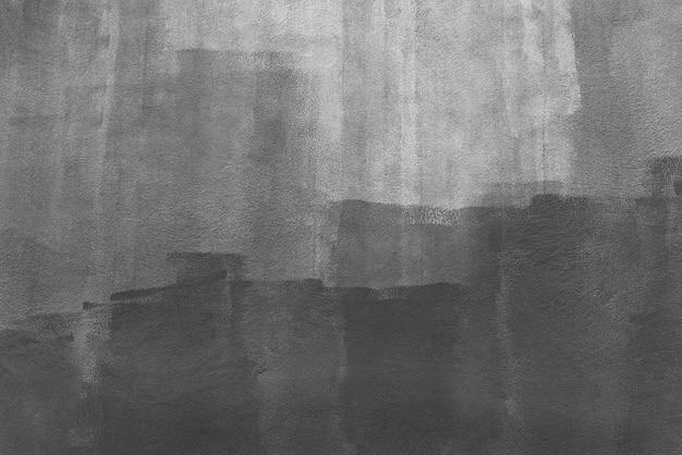 白い壁に描かれた黒い色からの抽象的な背景。アートの背景 Premium写真