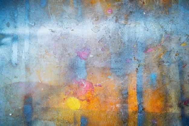カラフルな抽象的な背景からグランジの壁に描かれたと傷。 Premium写真