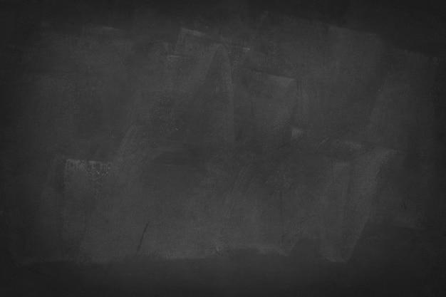 水平の黒板または黒板の背景を持つ暗いセメント Premium写真