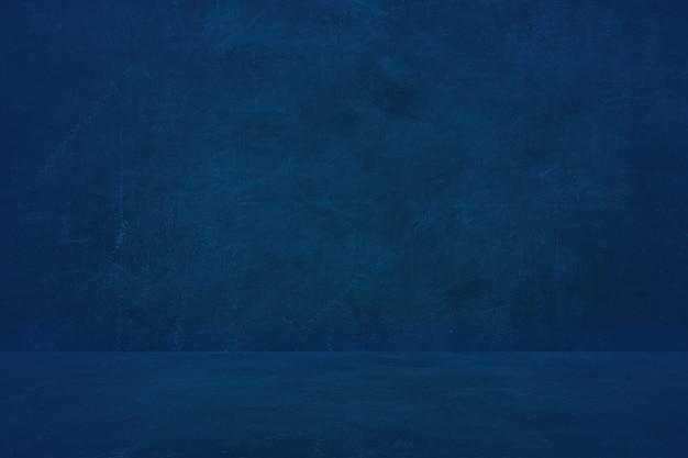 暗い青色のセメントの壁の背景、製品を提示する空のショールーム Premium写真
