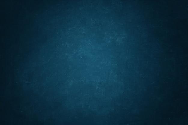 ダークブルーの黒板壁の背景 Premium写真