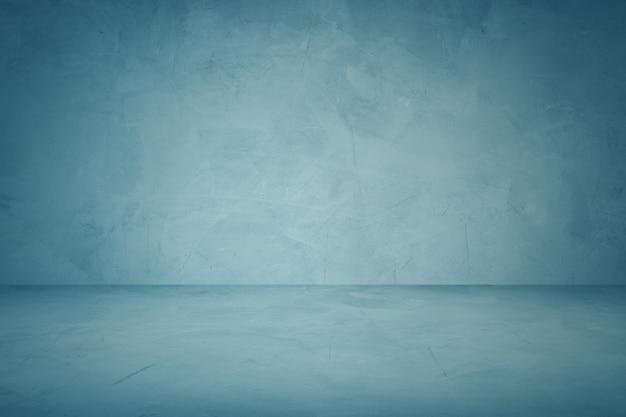 ダークブルーのセメントの壁とビンテージ背景スタジオの背景 Premium写真