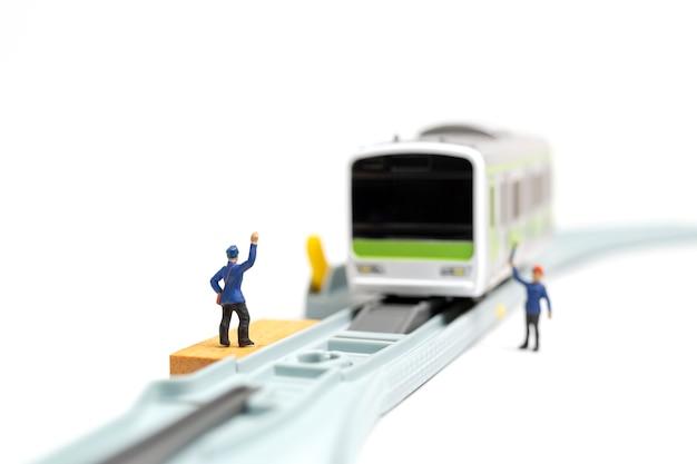 ミニチュア人:鉄道スタッフ Premium写真