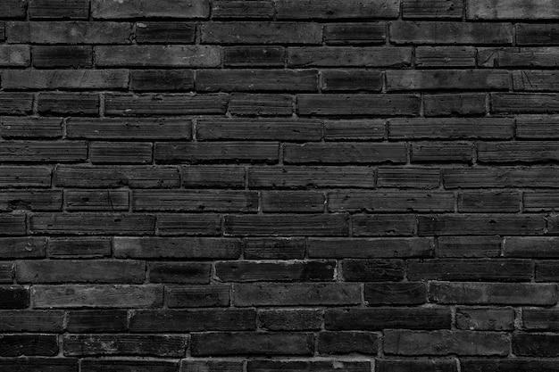 背景の黒い壁の大きなテクスチャ。 Premium写真