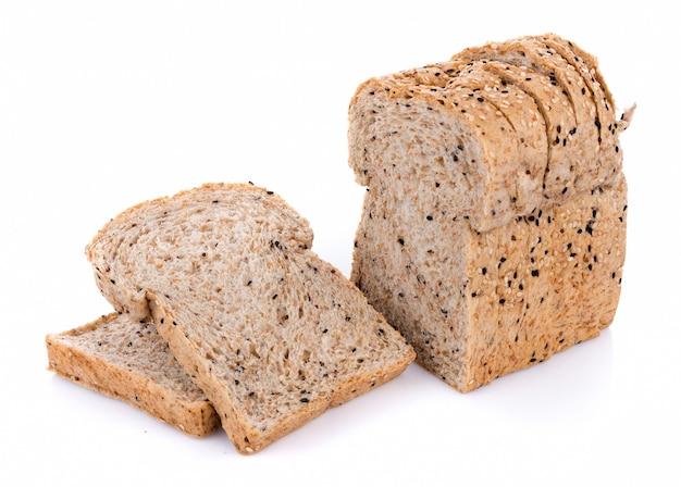 白で隔離される全粒小麦パン Premium写真