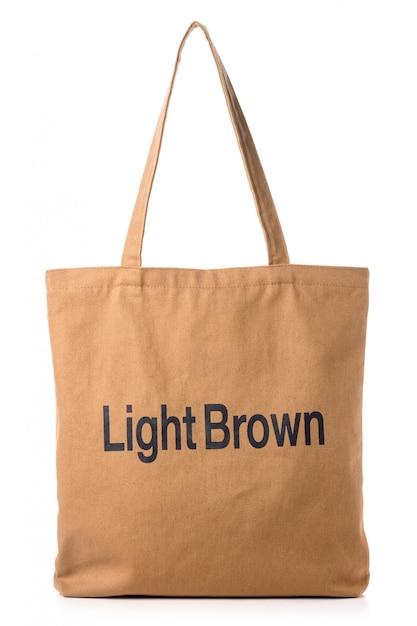 Новая пустая коричневая сумка из хлопка на белом фоне Premium Фотографии