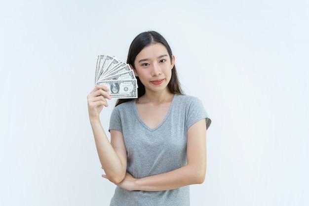 アジアの女の子、お金、銀行、コンセプト、ドル、お金 Premium写真