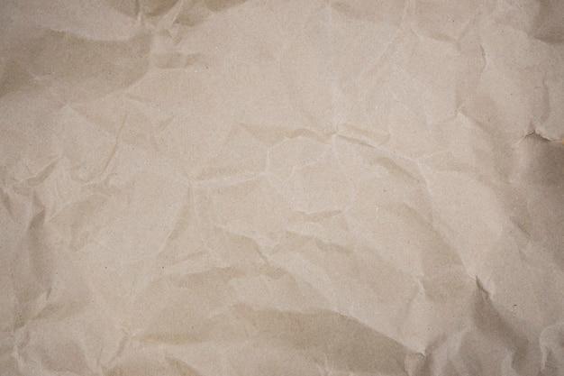 折り畳まれた茶色の紙の背景 Premium写真