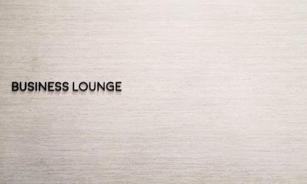 大理石の壁にビジネスラウンジラベル名 Premium写真