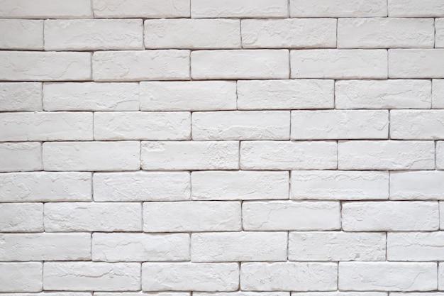 Белая кирпичная стена текстуры картины. сырой винтаж чистый стиль фона. Premium Фотографии