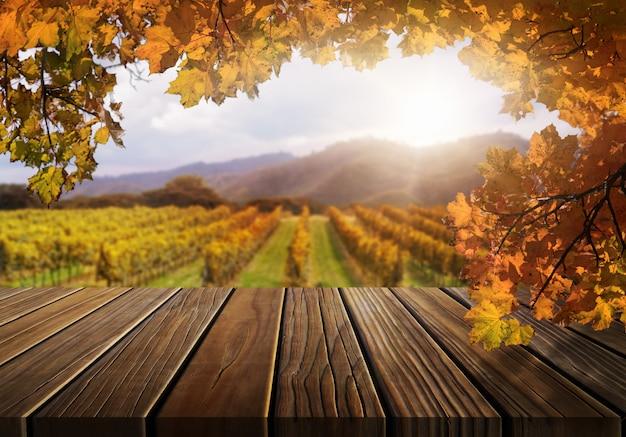 秋のブドウ畑の国の風景の木製テーブル。 Premium写真