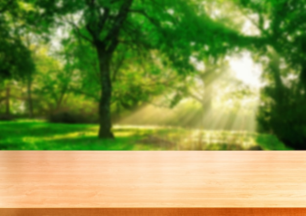 緑の茶色の木のテーブルは、自然の背景をぼかし。 Premium写真