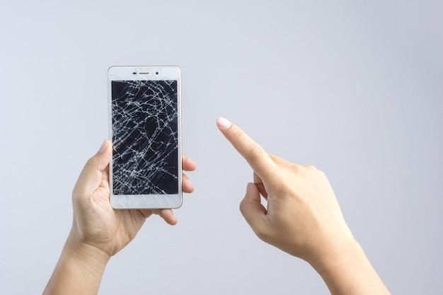 手、壊れた、画面、携帯電話 Premium写真