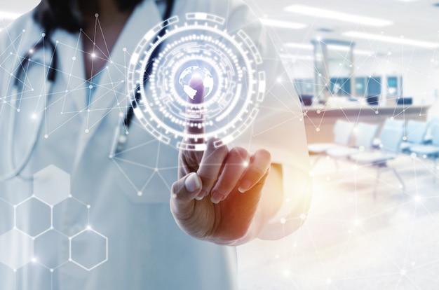 データデジタル世界ネットワーク接続ホログラムに触れることを指している聴診器手で女医 Premium写真