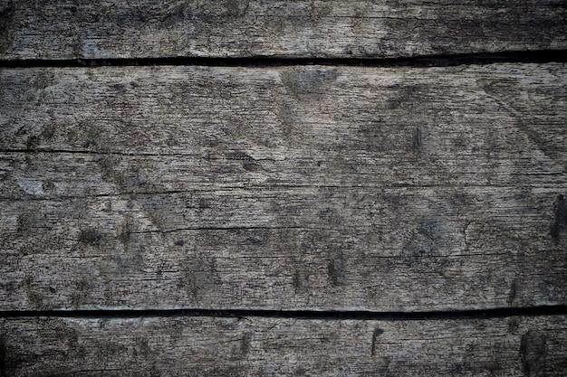 ダークウッドのテクスチャ背景の古い自然なパターンを持つ表面。黒い壁ウッドテクスチャ背景(横方向)のクローズアップ Premium写真