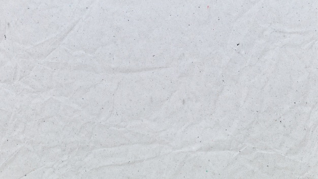 ビジネスコミュニケーションおよび教育のためのしわくちゃの白いリサイクル紙の背景 Premium写真