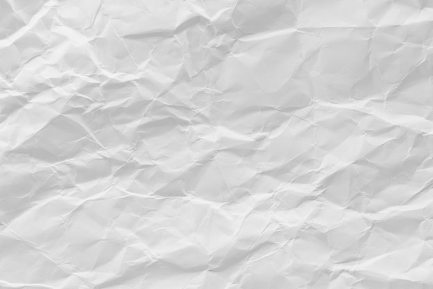 白のしわくちゃのリサイクル紙テクスチャ背景。 Premium写真