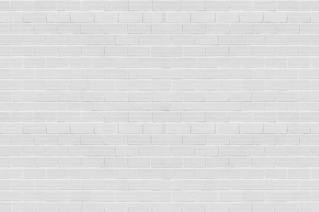 白いレンガ壁の背景テクスチャ Premium写真