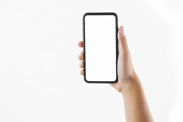 Крупным планом рука женщина, держащая черный смартфон пустой экран, изолированные Premium Фотографии
