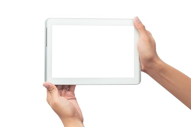 Мужская рука держа белый компьютер пк таблетки при пустой экран изолированный на белой предпосылке с путем клиппирования. Premium Фотографии