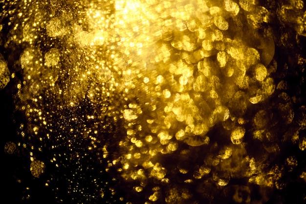 黄金の輝きボケ照明テクスチャぼやけた抽象的な背景 Premium写真