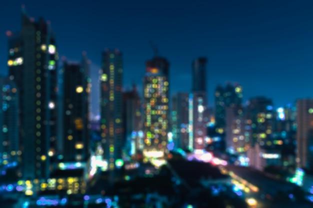 Размытые бангкок ночной вид с небоскребом в деловом районе в бангкоке, таиланд Premium Фотографии