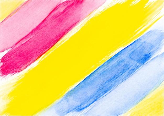白地に赤黄色と青の抽象的な水彩ブラシストローク。 Premium写真
