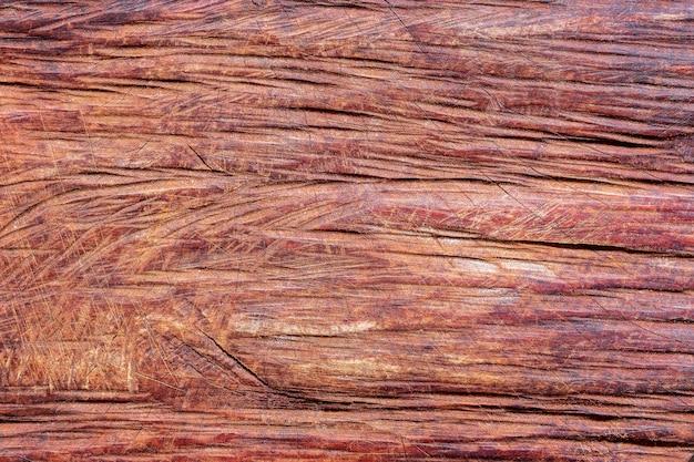 チェーンソーで木を切るの背景テクスチャです。木材と家具の概念。 Premium写真