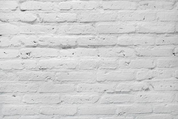 Белая текстура кирпичной стены для предпосылки. Premium Фотографии