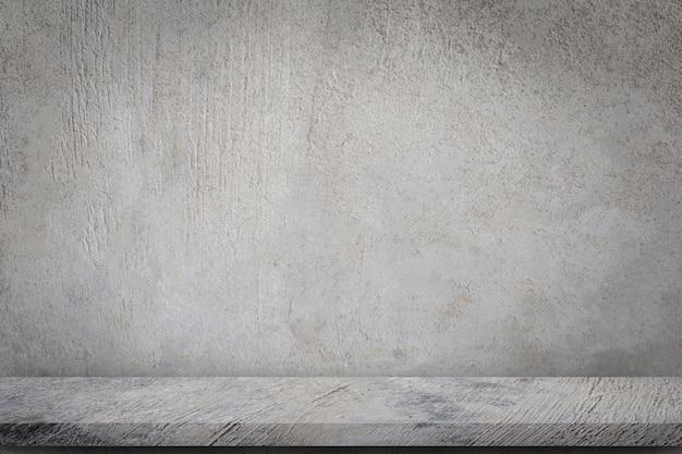 空の灰色のコンクリート壁の背景を持つコンクリートの床。 Premium写真
