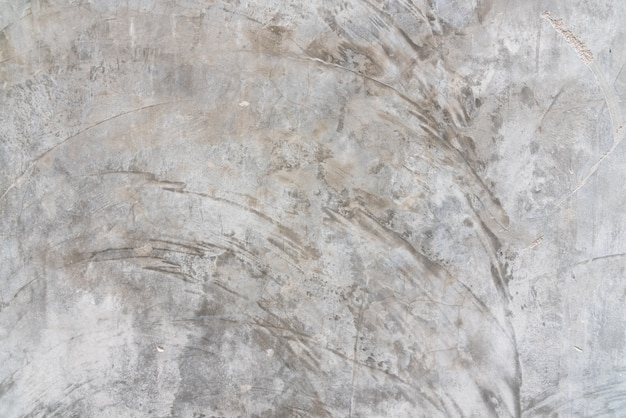 粗いひび割れがあり滑らかではないセメント壁特有のテクスチャ表面パターン Premium写真