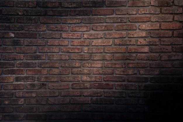 古いヴィンテージのレンガの壁、背景の装飾的な暗いレンガの壁の表面 Premium写真
