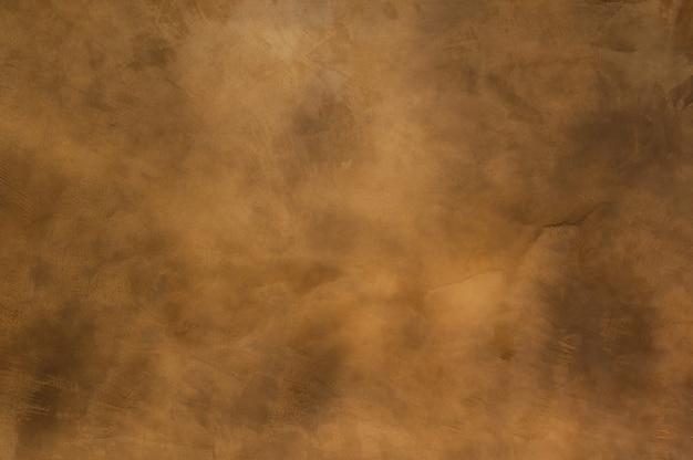 背景、茶色の汚れた壁としてオレンジ茶色コンクリートのテクスチャ Premium写真