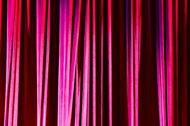 テクスチャ背景の赤いカーテン。 Premium写真