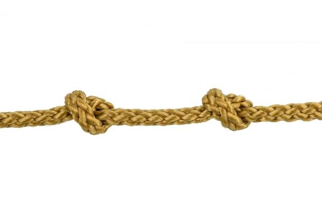 Шпагат веревка или джутовая веревка с узлом, изолированные на белом Premium Фотографии