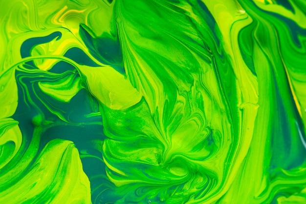 カラフルなアートペイントの背景、緑と黄色 Premium写真