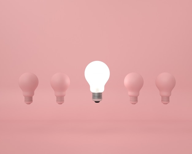 Разница лампочка на розовом. минимальная креативная идея концепции. Premium Фотографии