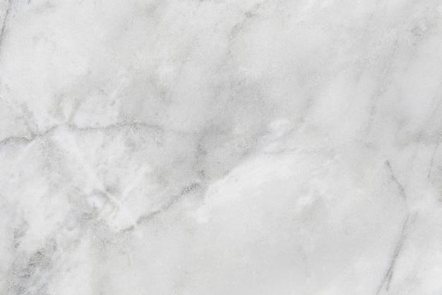 Белая мраморная текстура грязная, есть пыль фон и каменный узор. Premium Фотографии