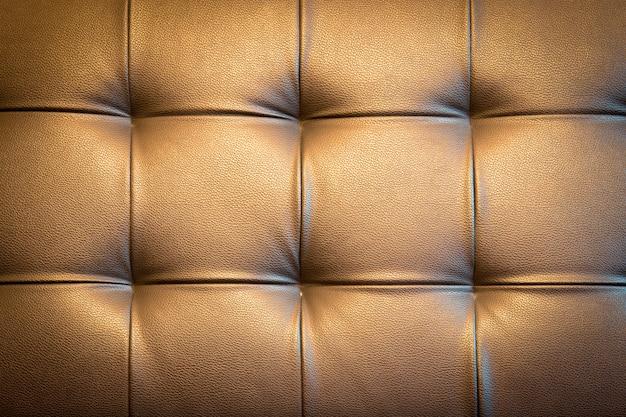 黄金色のトーンで豪華な装飾のための本革張りの背景 Premium写真