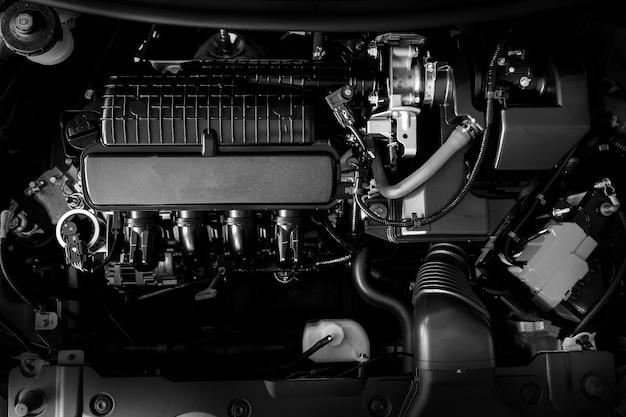 車のエンジンのモーターの概念新しい自動車エンジンの部分の詳細を閉じます白黒。 Premium写真