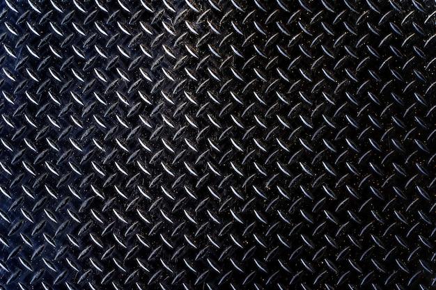 鉄板黒テクスチャ背景古い風化した金属ダイヤモンド板 Premium写真