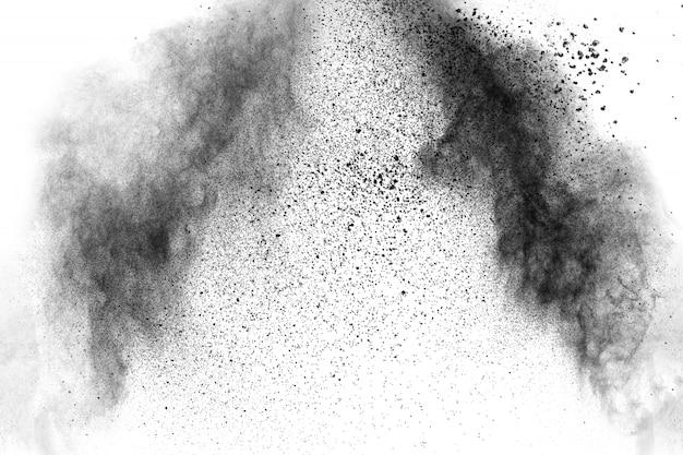 Черные частицы брызги на белом фоне. взрыв пыли черного порошка. Premium Фотографии